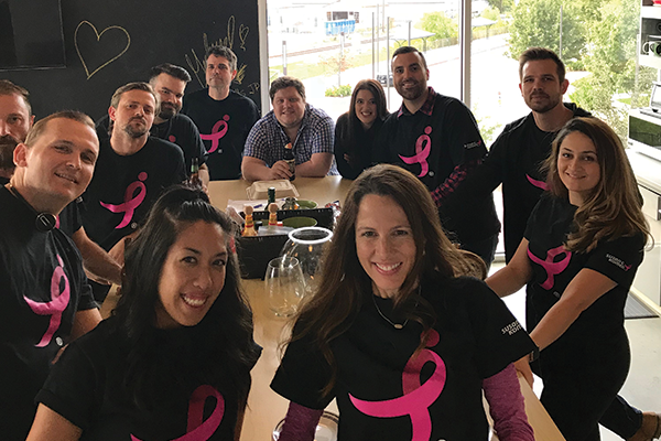 EZ Texting team celebrates breast cancer survivor