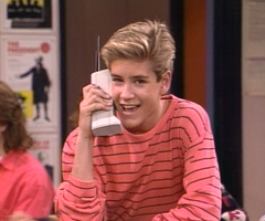 Zach Morris shows off an early mobile phone